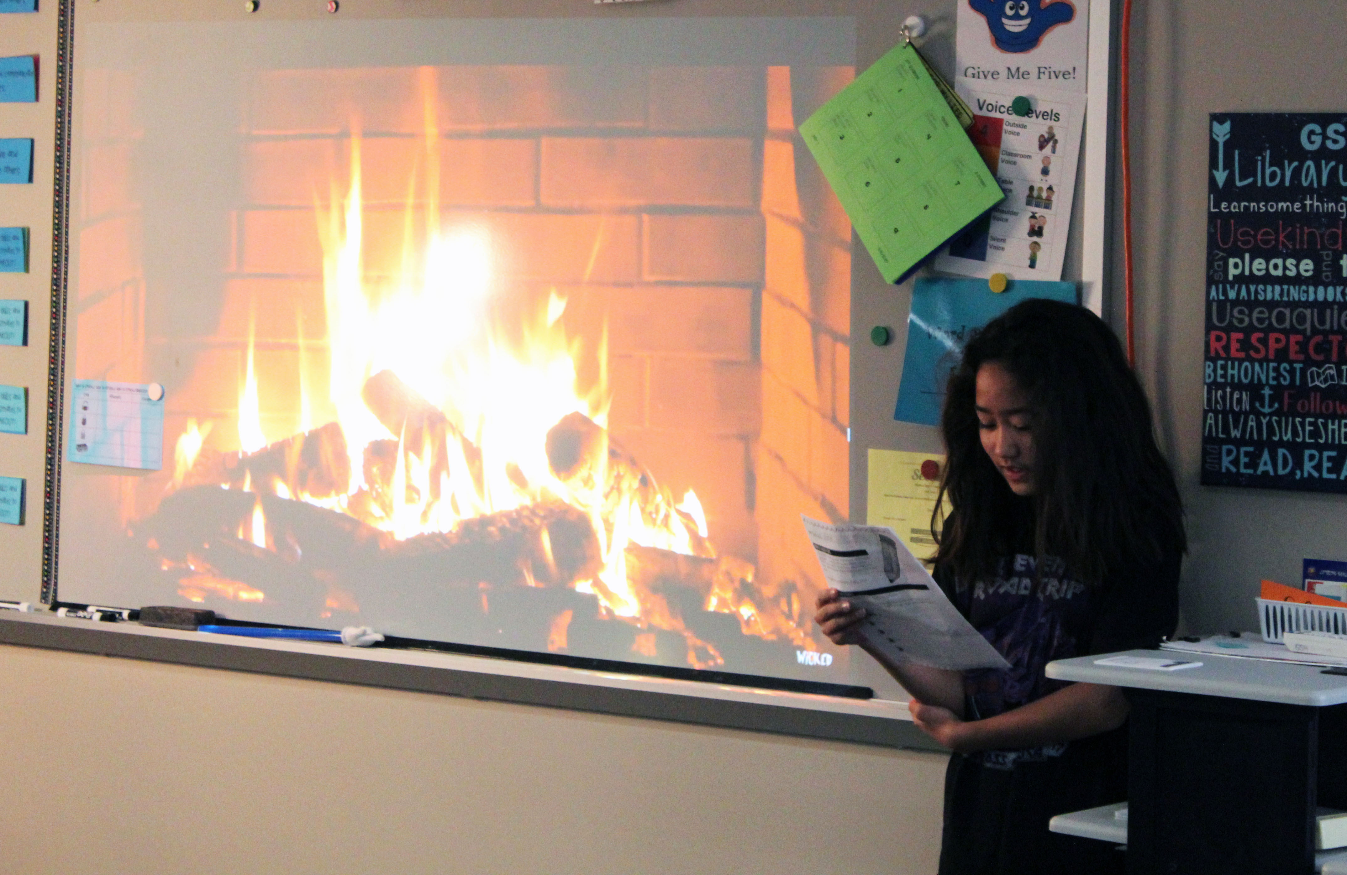 students read their poems in front of the class