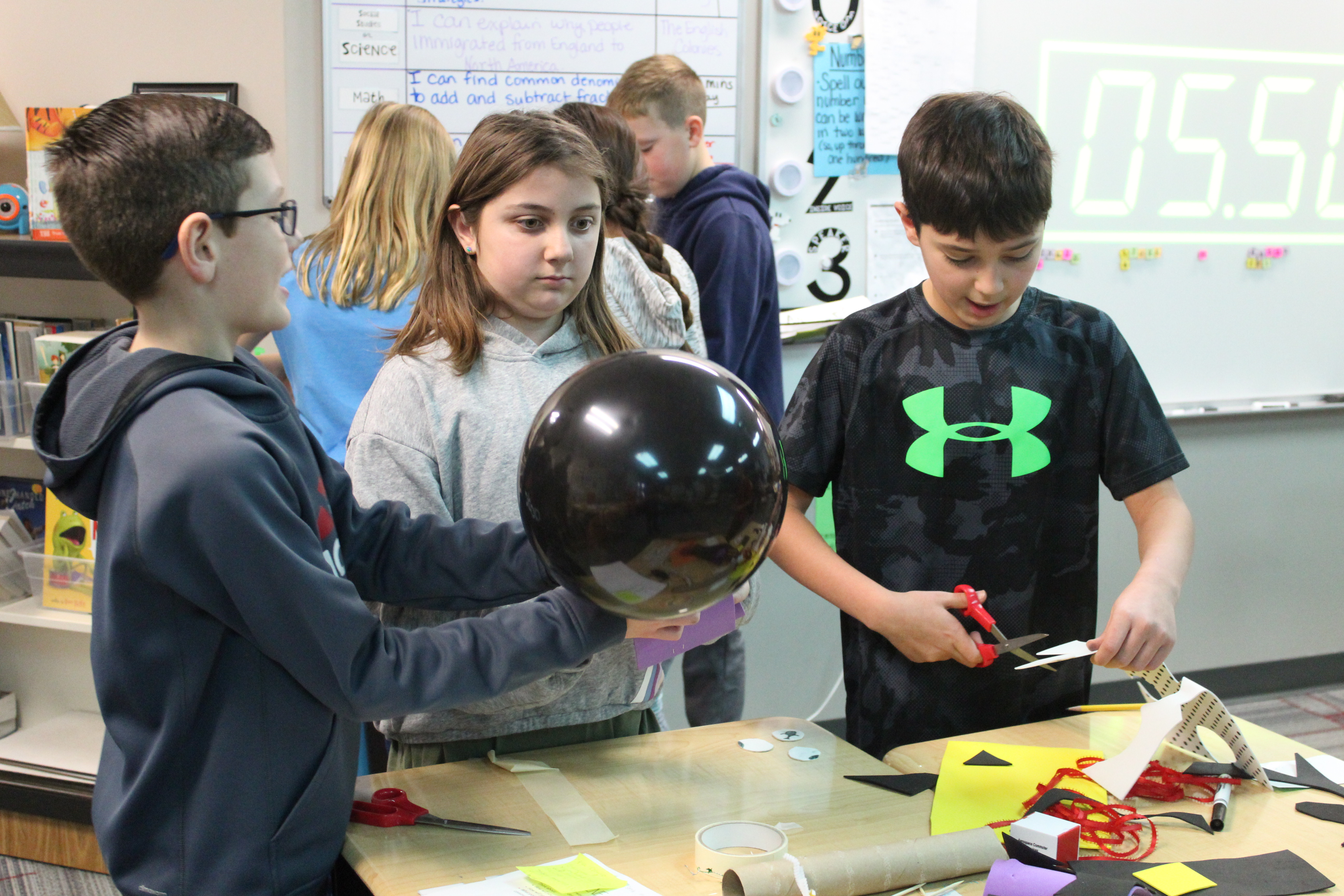 Prairie Queen Elementary students build balloon floats for Thanksgiving Day parade