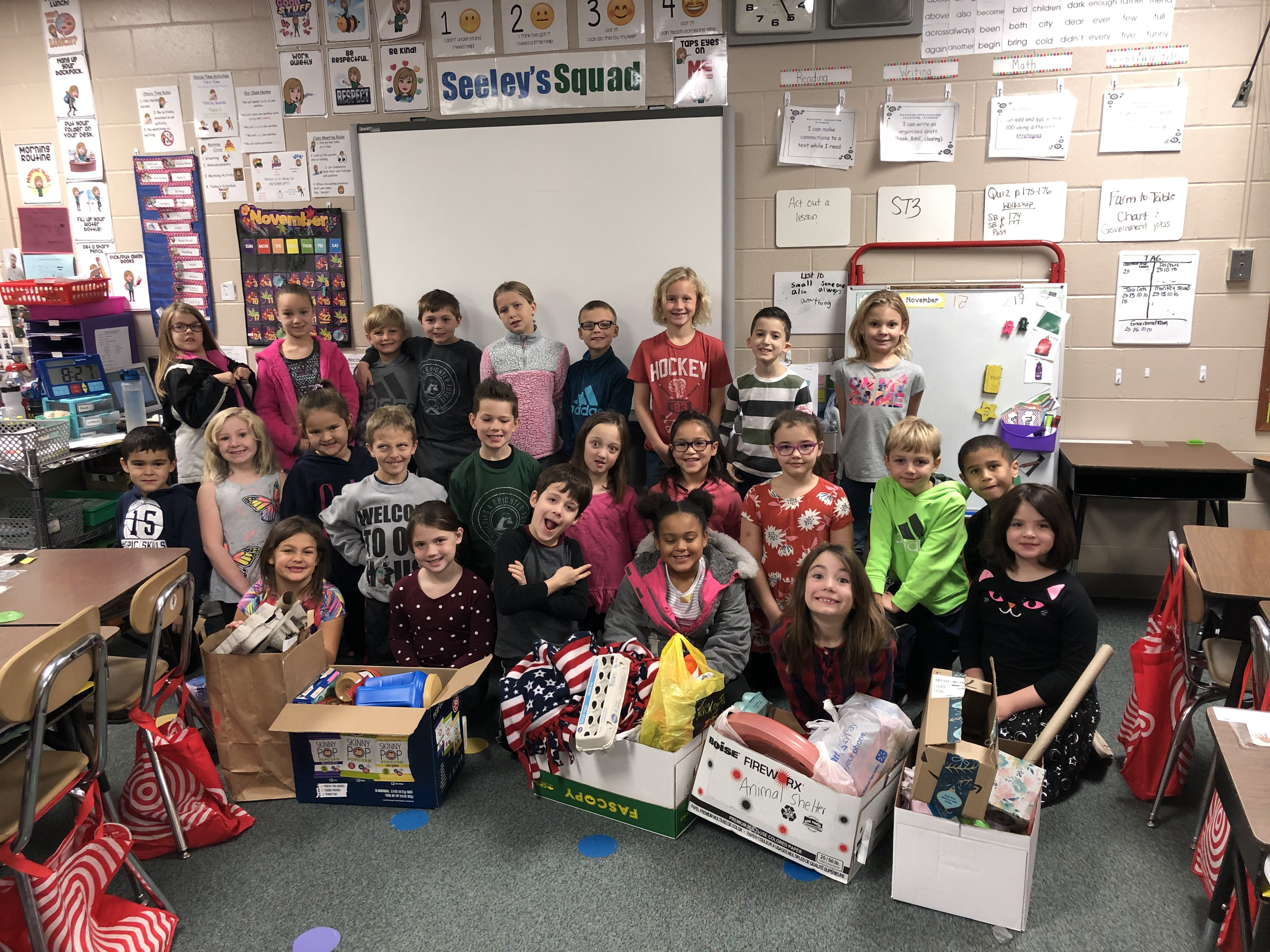 Students pose with donations for humane society