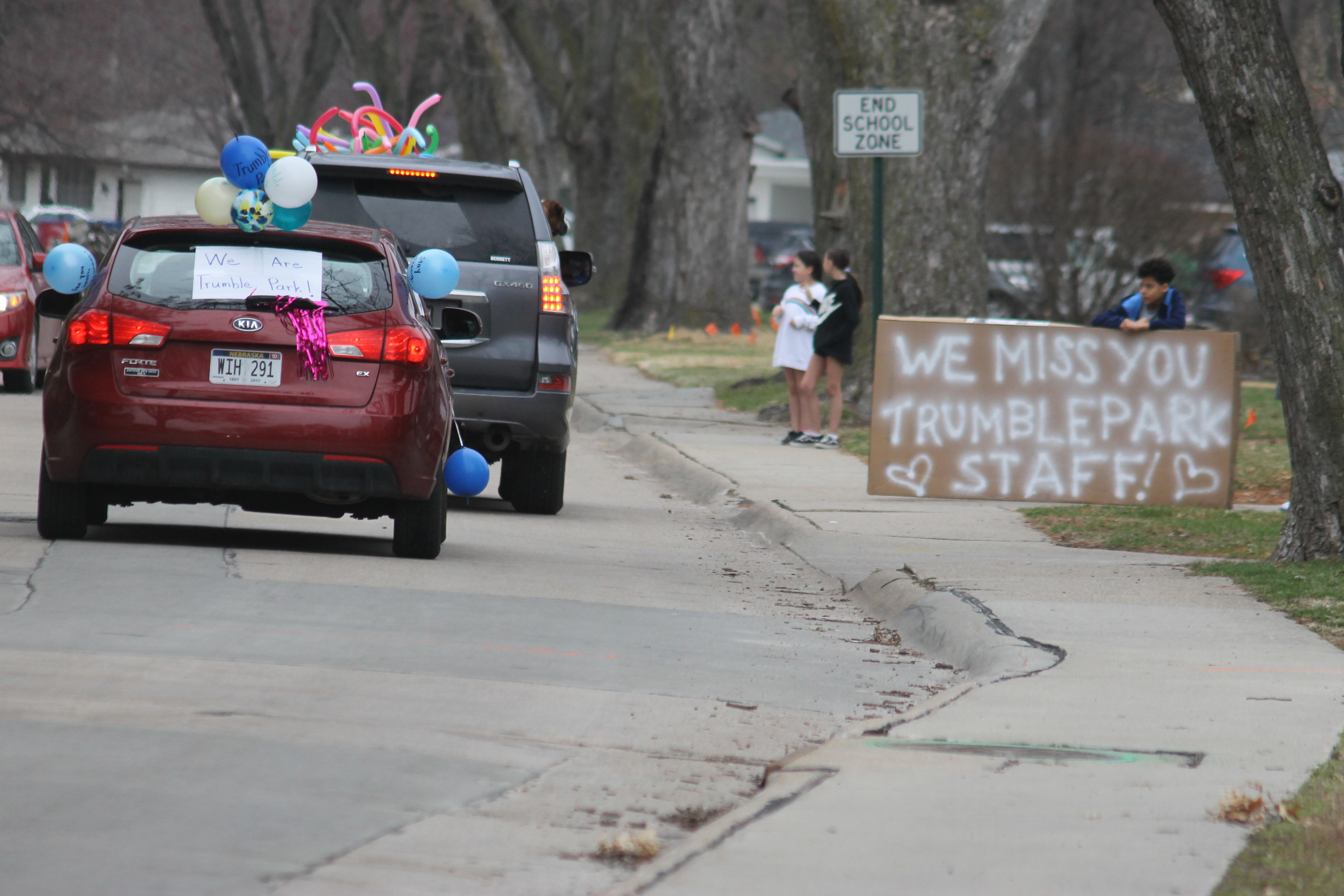 Trumble Park teachers wave to students as part of car parade