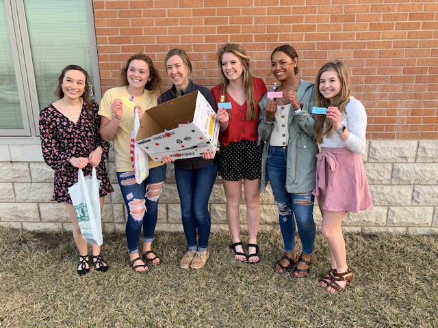 NHS students pose with kindness notes