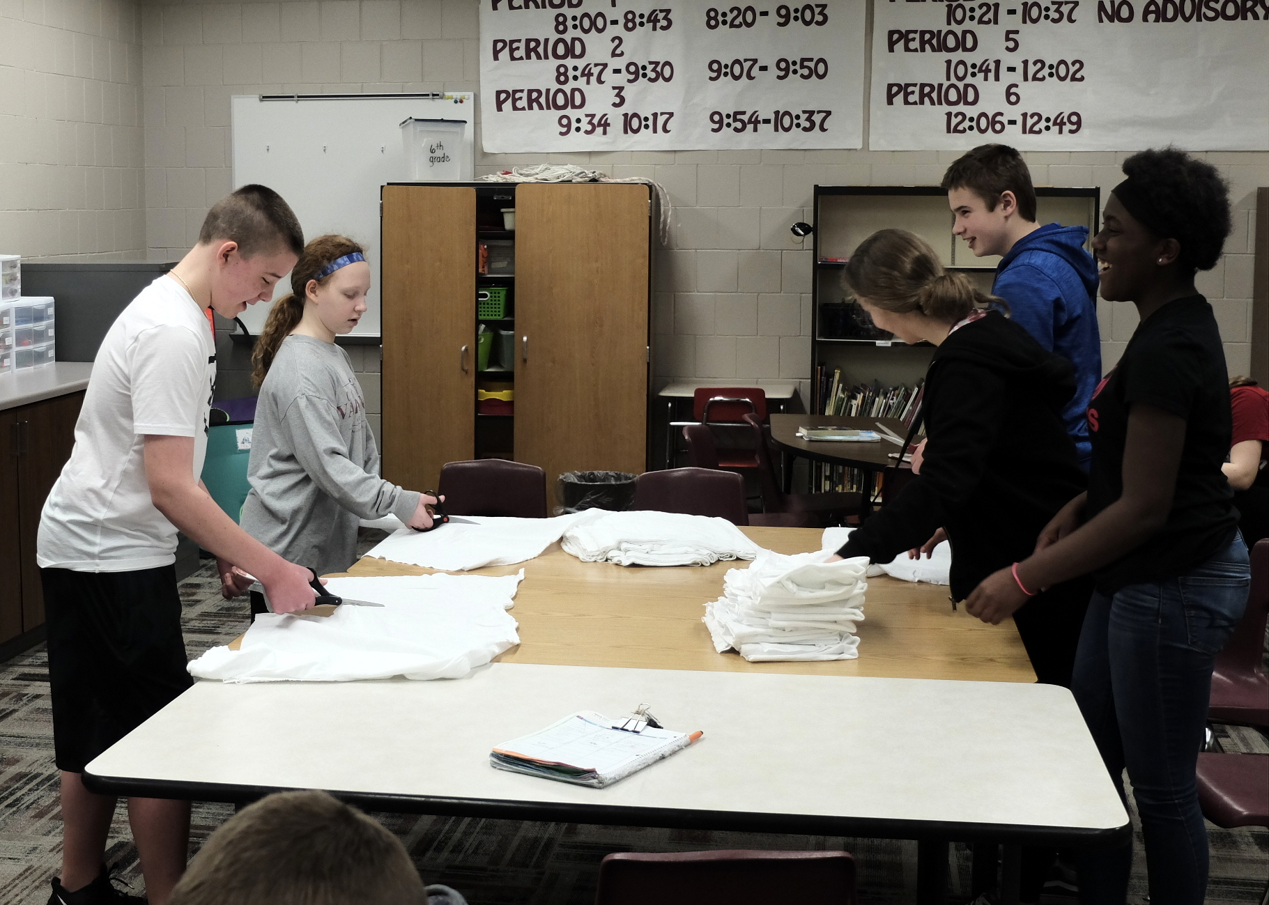 La Vista Middle students spent time cutting and folding cleaning rags for flood victims.