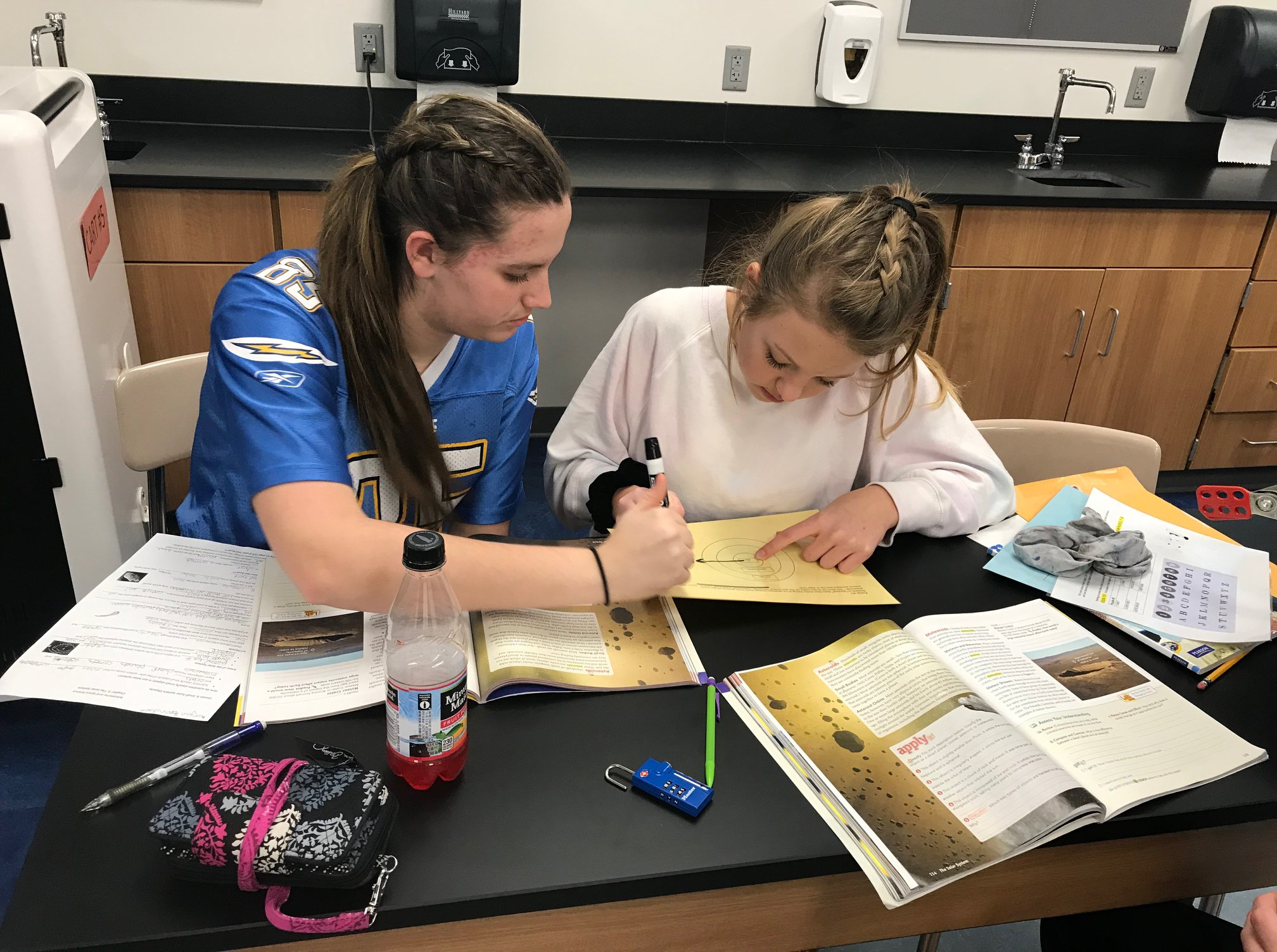 Two students working on a science project in class.