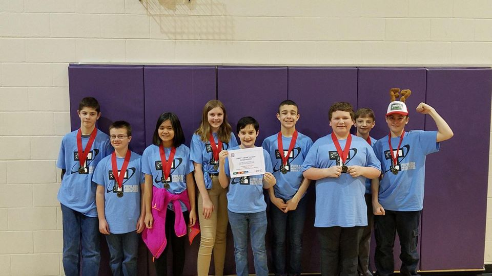 Papillion Middle School Students hold award won at FIRST LEGO league.