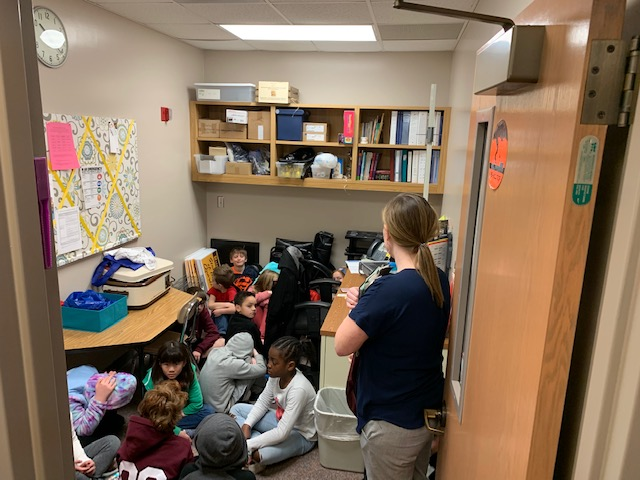 Students huddle together during a tornado drill.