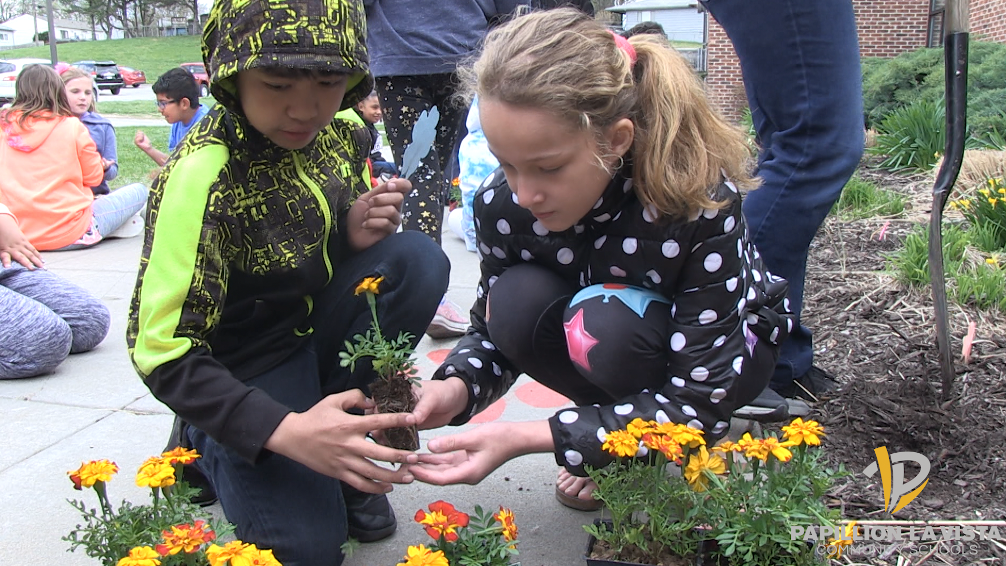 Students plant flowers for Earth Day