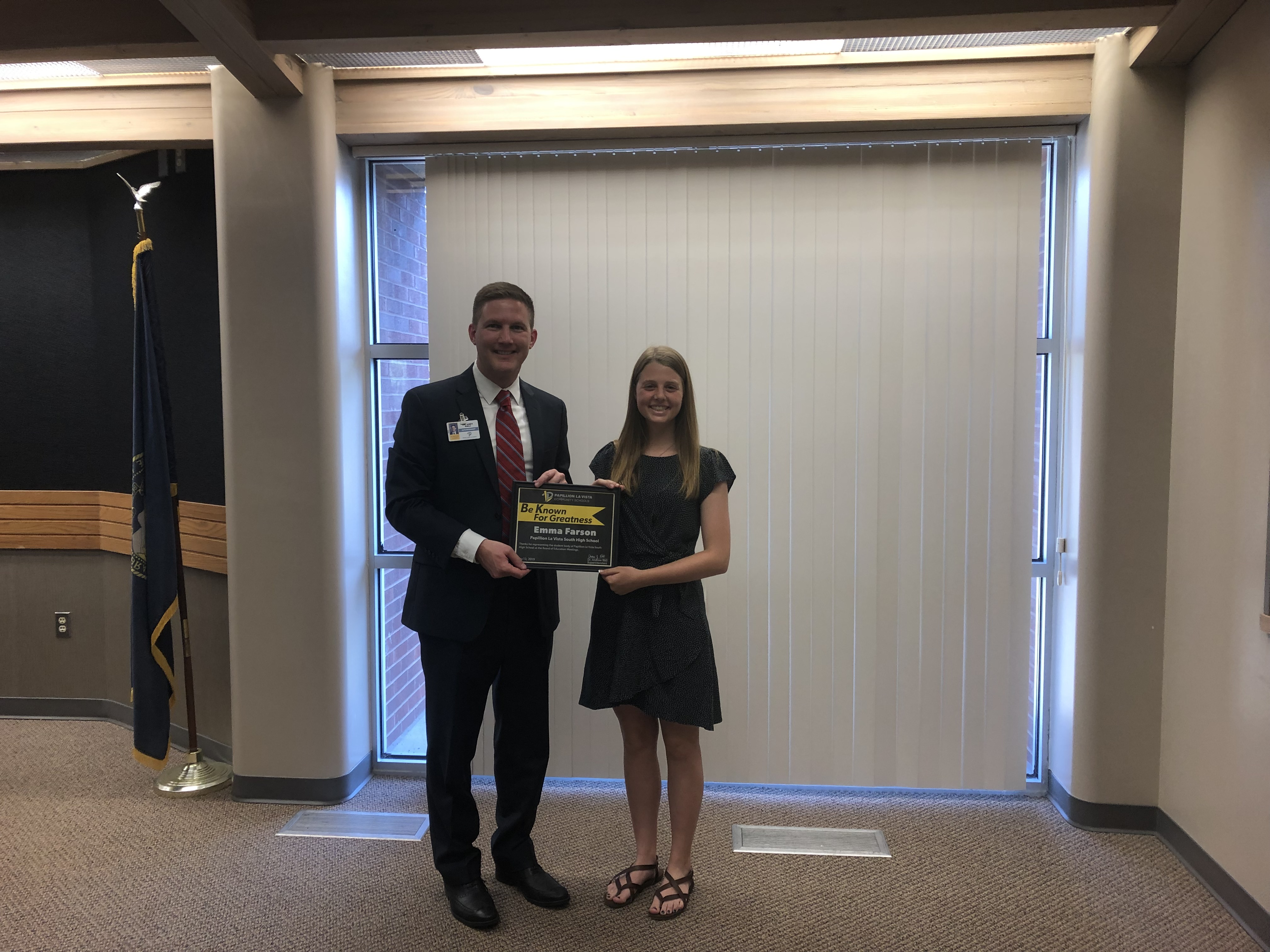 Emma Farson stands with Dr. Rikli to accept award
