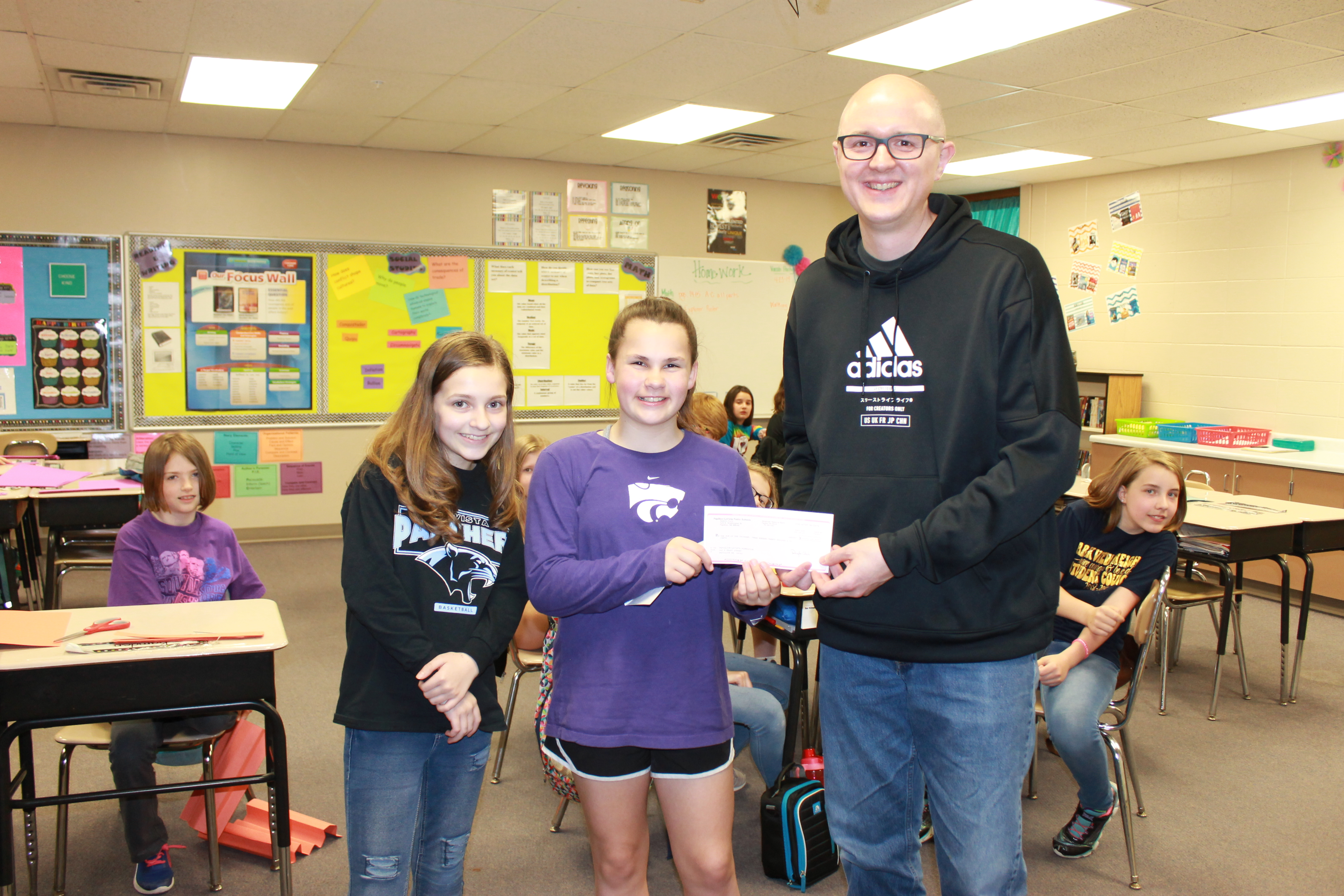 Student council presents a check to PLCS foundation