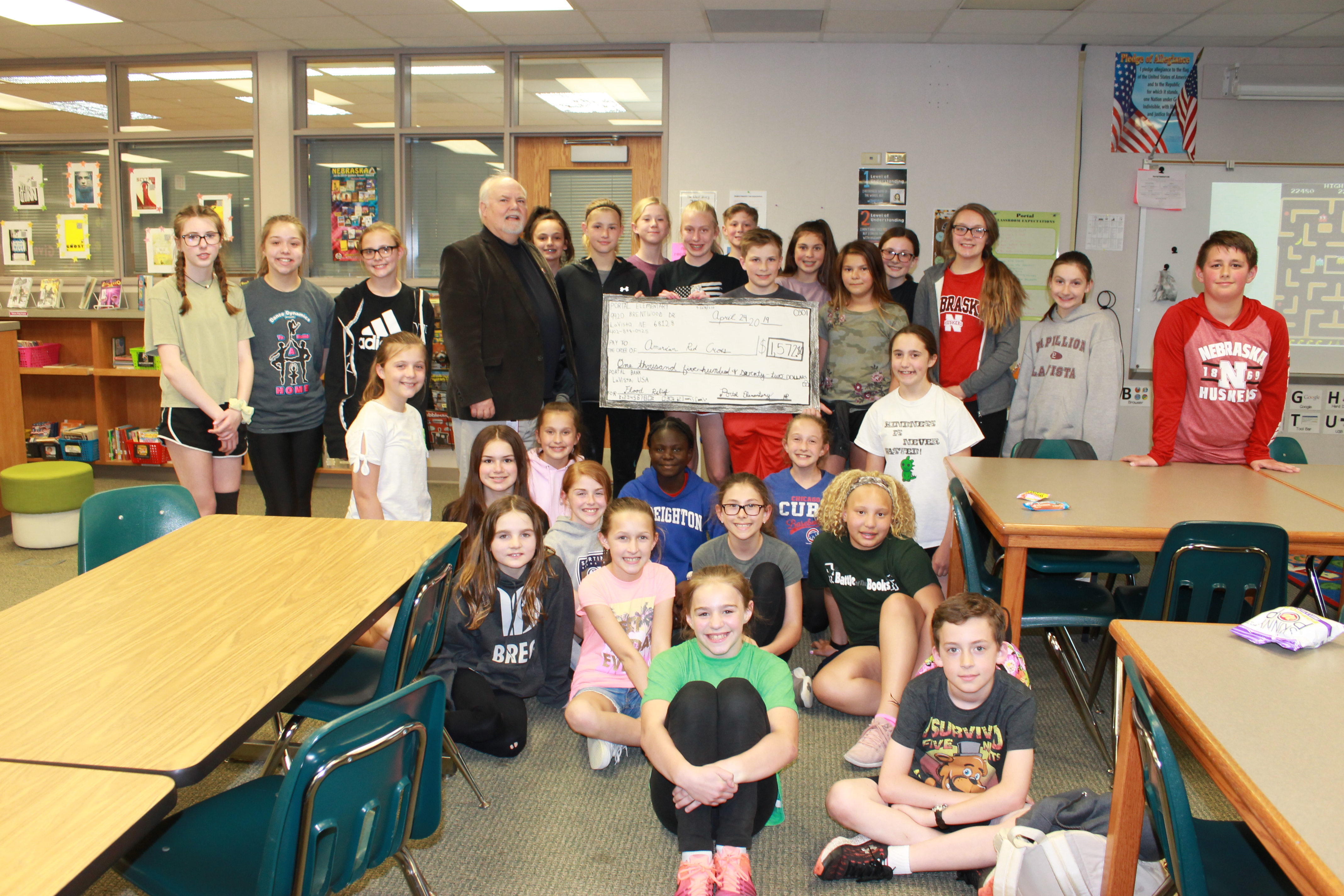 Portal Elementary donates an additional $1,572 to Red Cross through hat fundraiser