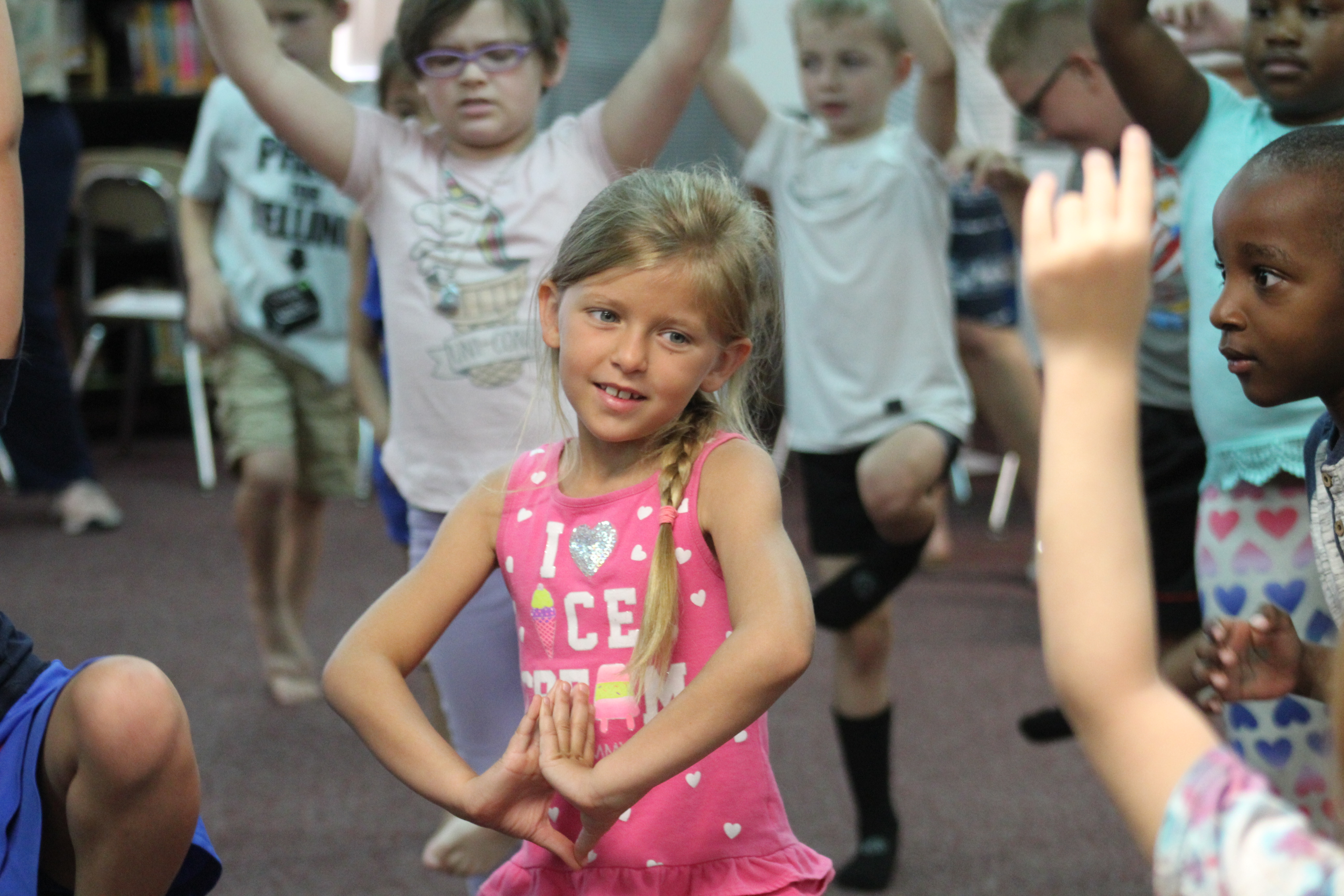 Camp Super Reader students practice yoga thanks to local business