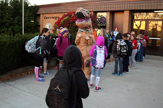 Carriage Hill Elementary School Principal Kelcy Tapp dressed up as a Tyrannosaurus Rex on Oct. 24