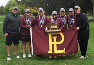 Monarch girls golf team shows off their flag and trophy after winning the state championship