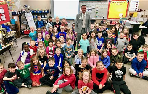 Dr. Rikli poses with the 3rd grade class from Rumsey Station during a recent class visit.