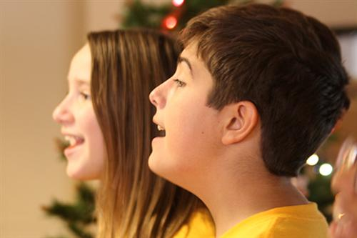 Kara Norman and Anthony Luna sing at Papillion Manor on Dec. 8, 2016.