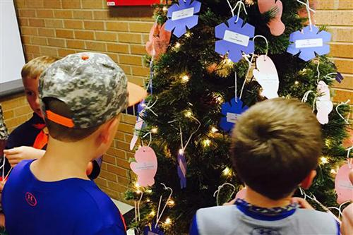Patriot Elementary School families selected tags from a Giving Tree on Thursday, Nov. 18