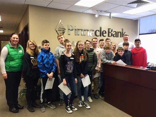 PLCS students learning about business pose for a photo at Pinnacle Bank.