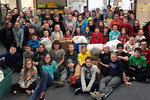 Sixth-graders at Hickory Hill Elementary School delivered a donation of more than 700 items to NHS.
