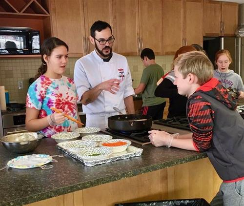PLCS HAL students work with a HyVee Chef during a recent visit to expand culinary skills