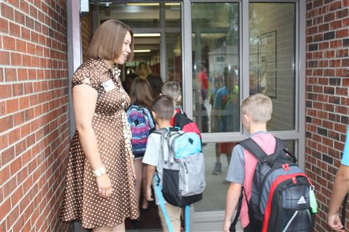 La Vista West Principal DerNecia Harris welcomes students back to school for the first day of classes.