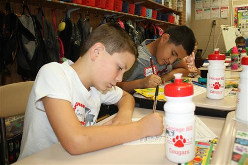 Carriage Hill Elementary students start classwork at their desks on first day.