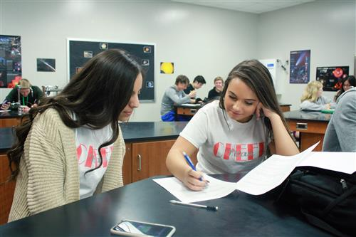 Two students study a worksheet in a classroom at Papillion La Vista South High School.