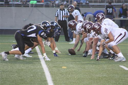 Monarch football players line up against Titan football players during a game in 2016.