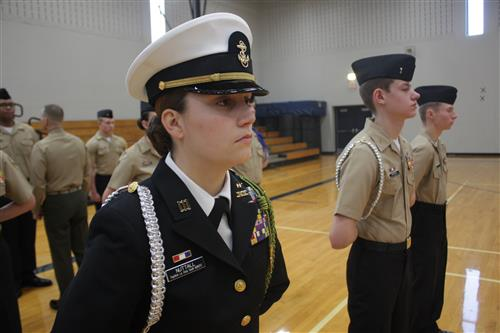 A NJROTC cadet stands in formation during a recent inspection with other cadets.