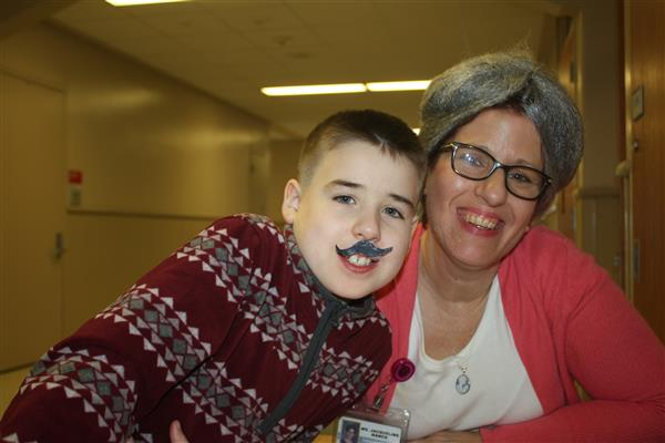 Photo 11 Landon Fulton poses with paraeducator Jacqueline Nance dressed as 100 year olds.
