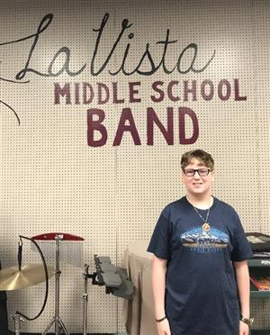 La Vista Middle School 8th Grader Ian Maass poses for a picture in the band room after being named to All-State band.