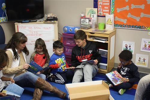 LVMS Secretary Kari Armstrong and 8th grade student Bryce Woodward read with Sarpy County Headstart