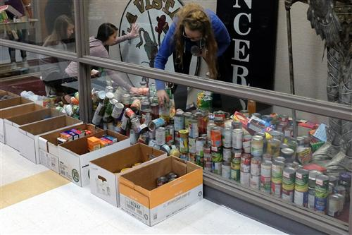 La Vista Middle School Student Council members count 3,320 items for the Tri-City Food Pantry.