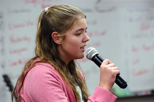 Emily Secord, a seventh-grader, sings a song at the Solo Singing Club.