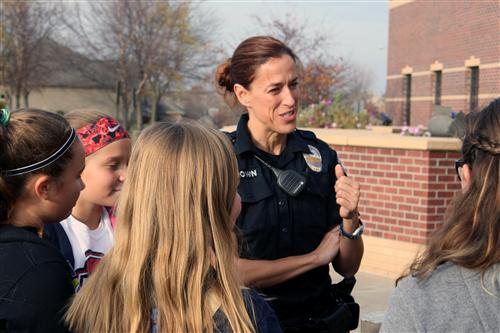 La Vista Police Officer Jamie Brown speaks with a group of Parkview Heights Elementary School stude