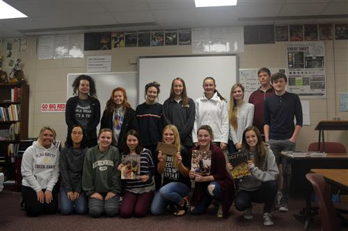Monarch Journalism students pose for picture holding up Cornhusker Award in classroom.