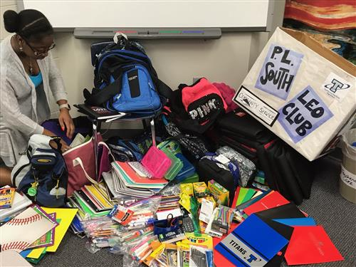 Senior Braniya Franklin sorts through over 400 items collected in donation drive.