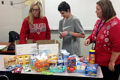 Students from the PLSHS special education department packed boxes to send to troops