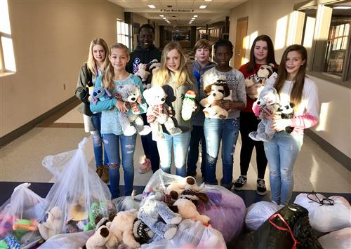 PMS LEO Club members poses with stuffed animal donations