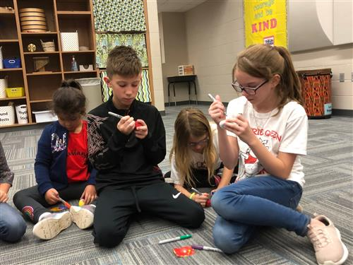 Students put finishing touches on Kindness Rocks