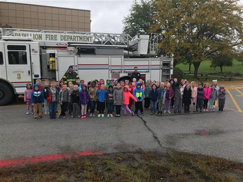 The Papillion Fire Department displays a fire truck for students at Hickory Hill Elementary.