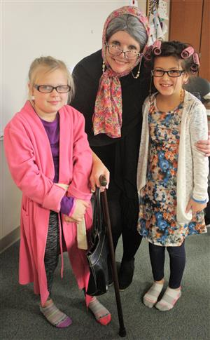 3rd grade teacher Christine Synowiecki stands with Marah McDougal and Kalynn Young dressed as 100 year olds.