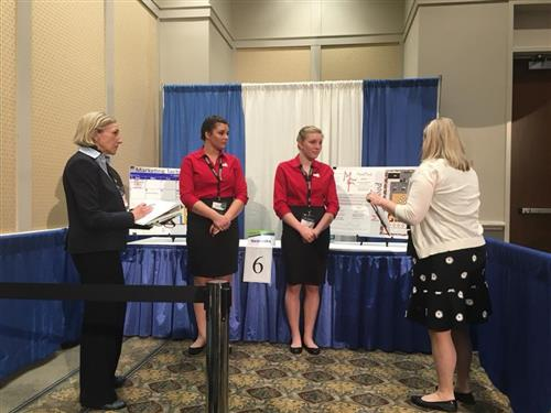Jazmin Koebel and Savana Moore present 'MoodFood' to a judge during National ProStart.