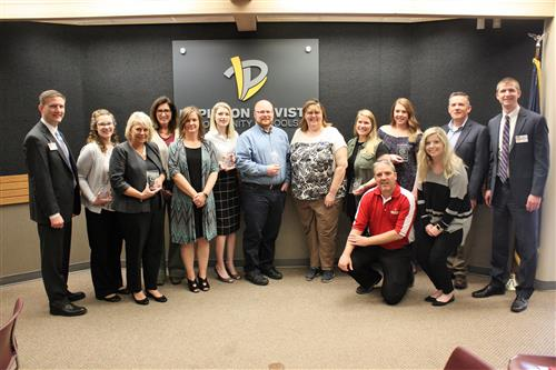 PLC Schools Cooperation BEST award winners pose for a picture at the PLCS Central Office