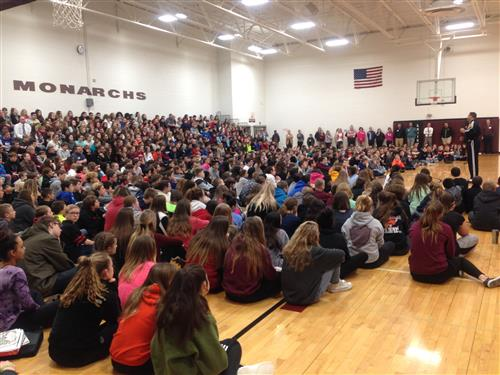 Jon Pritikin speaks in front of an all-school assembly inside La Vista Middle School on Jan. 18.