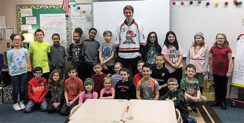 Nick Prebix of the Omaha Lancers poses for a picture with a Patriot Elementary class