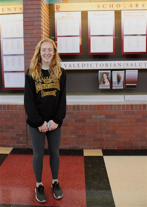 Mercy Milliken poses for picture after being named National Merit Semi Finalist