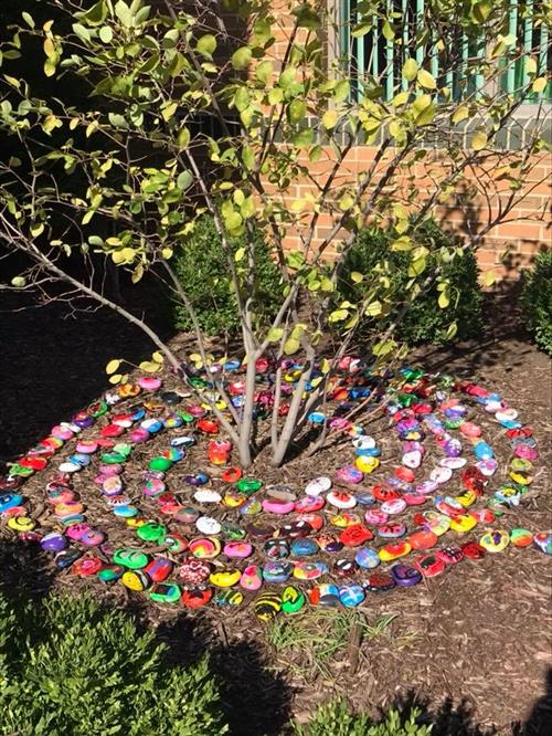 Kindness rocks planted in front of Portal Elementary School.