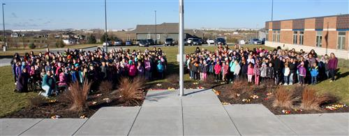 All staff and students at Prairie Queen Elementary pose for picture out in front of school