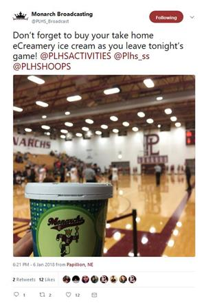 Twitter post of student holding up Monarch ice cream inside PLHS gym during basketball game.