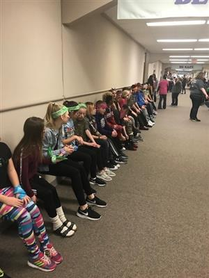 Walnut Creek 6th graders complete a wall sit as part of 100 exercises on the 100th minute of the 100th day of school.