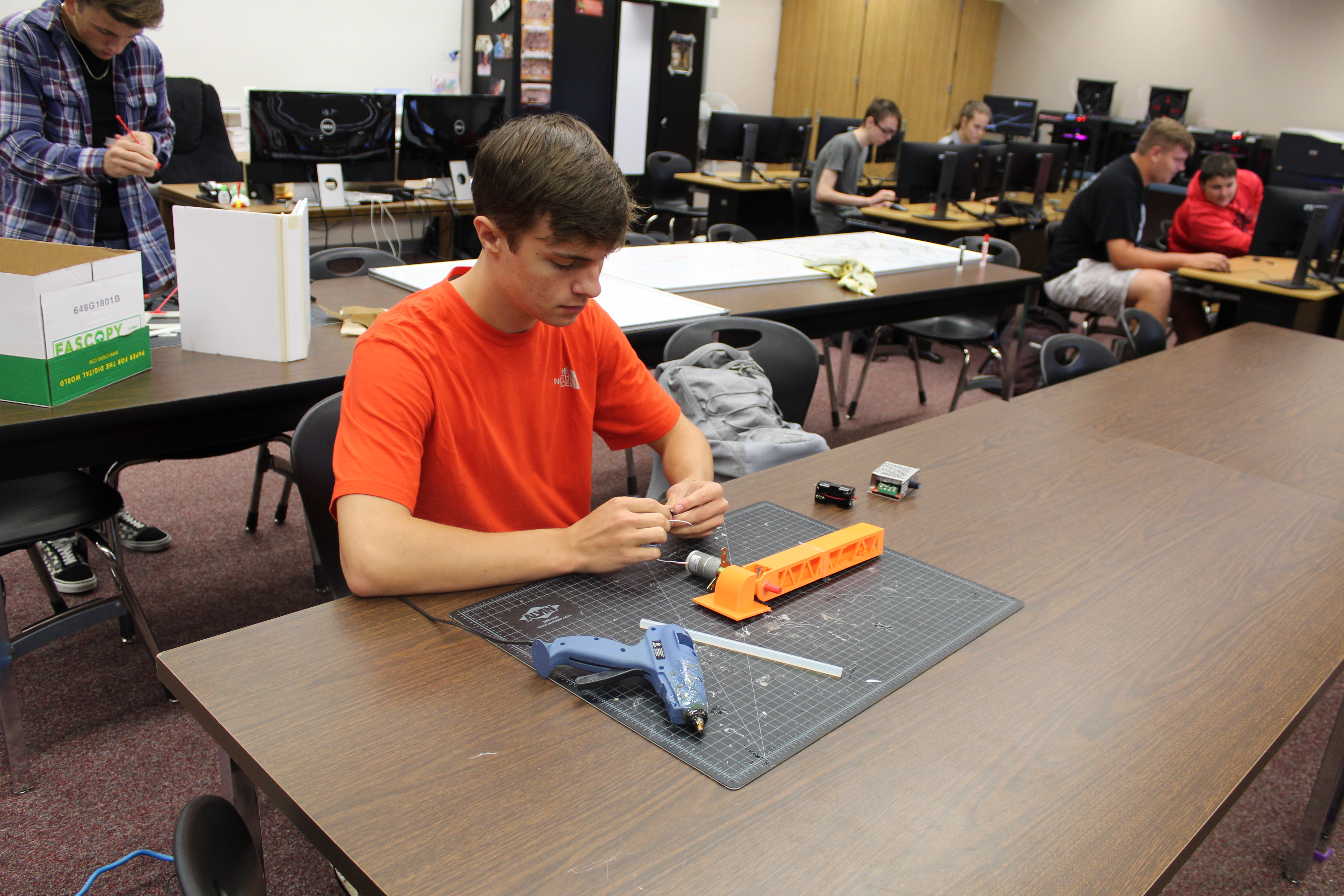 student working on a STEM project in class